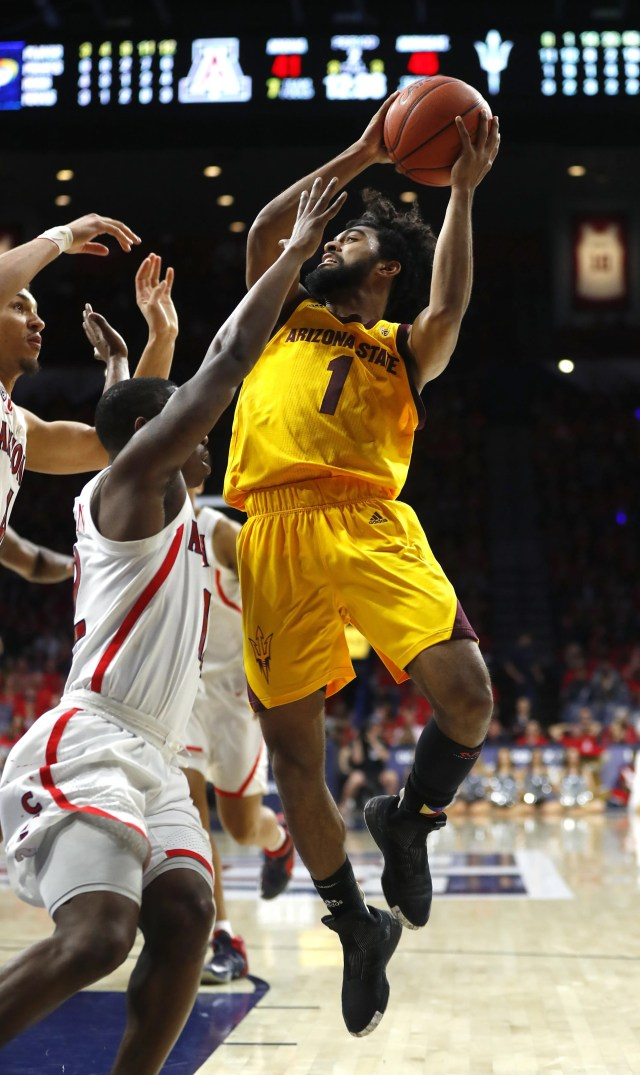 ASU's Remy Martin (1) makes a layup against Arizona's Justin Coleman (12) during the second half at the McKale Memorial Center in Tucson, Ariz. on March 9, 2019.