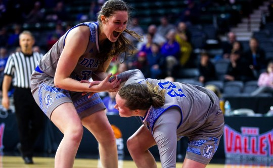 Drake guard Maddy Dean, right, gets helped up by teammate Drake forward Monica Burich (31) after drawing a foul during a NCAA Missouri Valley Conference women's basketball quarterfinal tournament game, Friday, March 15, 2019, at the TaxSlayer Center in Moline, Illinois.