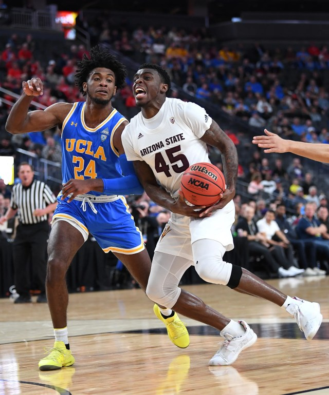Mar 14, 2019; Las Vegas, NV, United States;Arizona State Sun Devils forward Zylan Cheatham (45) reacts to being fouled as UCLA Bruins guard Jalen Hill (24) defends during the first half of a Pac-12 conference tournament game at T-Mobile Arena.