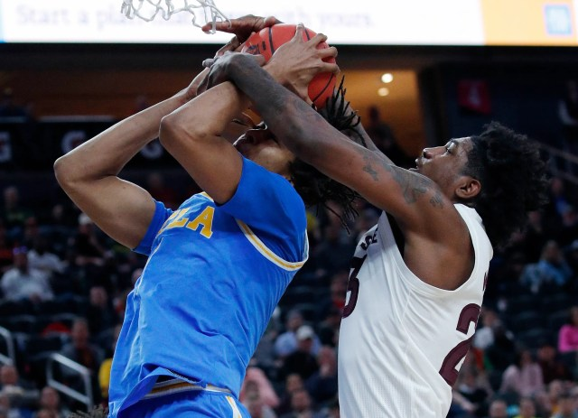 Arizona State's Romello White, right, fouls UCLA's Moses Brown during the first half of an NCAA college basketball game in the quarterfinals of the Pac-12 men's tournament Thursday, March 14, 2019, in Las Vegas.