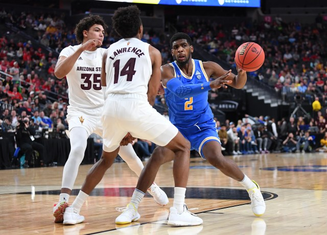Mar 14, 2019; Las Vegas, NV, United States; UCLA Bruins forward Cody Riley (2) passes away from Arizona State Sun Devils forward Kimani Lawrence (14) and Arizona State Sun Devils forward Taeshon Cherry (35) during the second half of a Pac-12 conference tournament game at T-Mobile Arena.