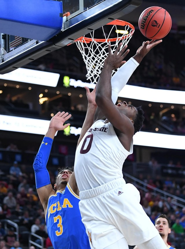 Mar 14, 2019; Las Vegas, NV, United States; Arizona State Sun Devils guard Luguentz Dort (0) shoots over UCLA Bruins guard Jules Bernard (3) during the first half of a Pac-12 conference tournament game at T-Mobile Arena.