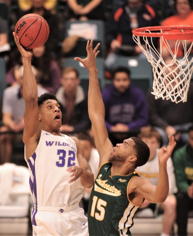 ACU's Joe Pleasant (32) shoots over Southeastern Louisiana's Maxewell Starwood. The Wildcats beat Southeastern Louisiana 69-66 in the Southland Conference Tournament semifinals Friday, March 15, 2019, at the Merrell Center in Katy.