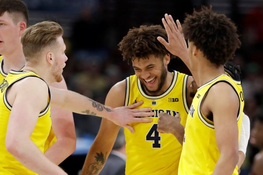 Michigan's Isaiah Livers (4) is congratulated why his teammates after a dunk shot during the first half of an NCAA college basketball game against Minnesota in the semifinals of the Big Ten Conference tournament, Saturday, March 16, 2019, in Chicago.