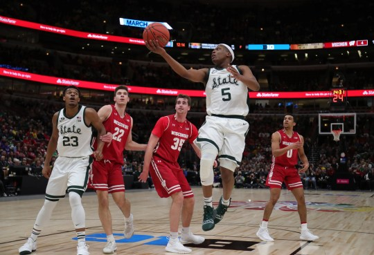 Michigan State guard Cassiuis Winston scores against Wisconsin defenders during first half action of the Big Ten tournament semifinal Saturday, March 16, 2019 at the United Center in Chicago.