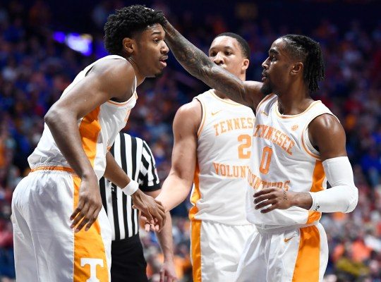 Tennessee striker Kyle Alexander (11), striker Grant Williams (2) and guard Jordan Bone (0) celebrate in the first half of the SEC Basketball game Basketball Championship against Bridgestone's Mississippi State Nashville, Tennessee Arena, Friday 15 March, 2019.