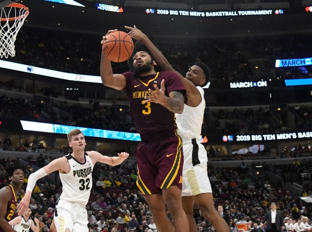 Mar 15, 2019; Chicago, IL, USA; Minnesota Golden Gophers forward Jordan Murphy (3) shoots against Purdue Boilermakers forward Aaron Wheeler (1) during the second half in the Big Ten conference tournament at United Center. Mandatory Credit: David Banks-USA TODAY Sports