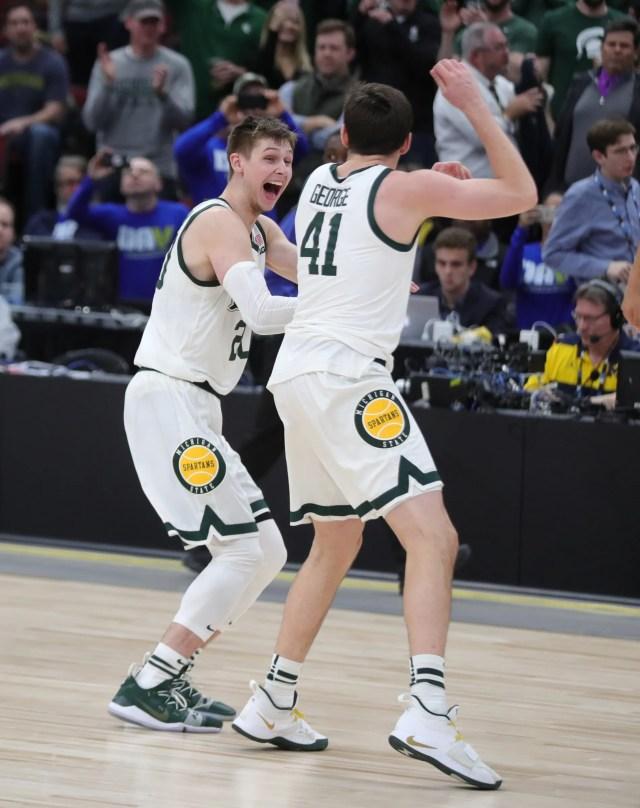 Michigan State's Matt McQuaid, left, and Connor George celebrate the 65-60 win against Michigan in the Big Ten tournament championship Sunday, March 17, 2019 at the United Center in Chicago.