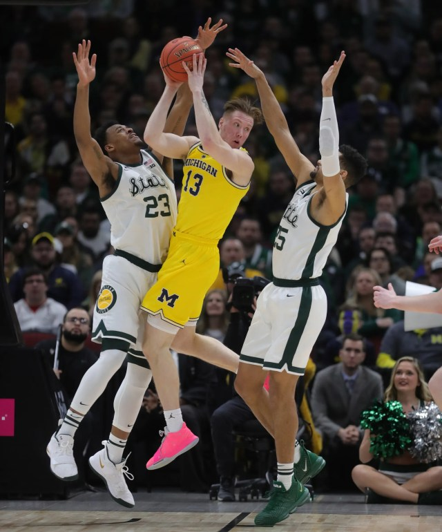 Michigan State forwards Xavier Tillman, left, and Kenny Goins defend Michigan forward Ignas Brazkeikis during the first half of the Big Ten tournament championship Sunday, March 17, 2019 at the United Center in Chicago.