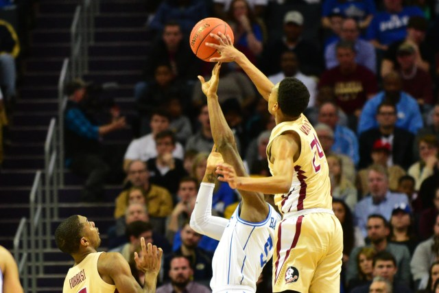 Florida State freshman forward Devin Vassell blocks a shot attempt by Duke freshman forward RJ Barrett during the first half of the ACC Championship game at the Spectrum Center on Saturday.