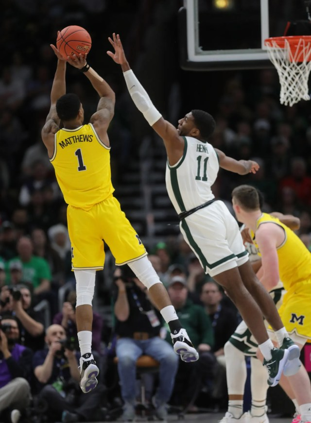 Michigan State's Aaron Henry defends Michigan's Charles Matthews during the first half of the Big Ten tournament championship Sunday, March 17, 2019 in Chicago.