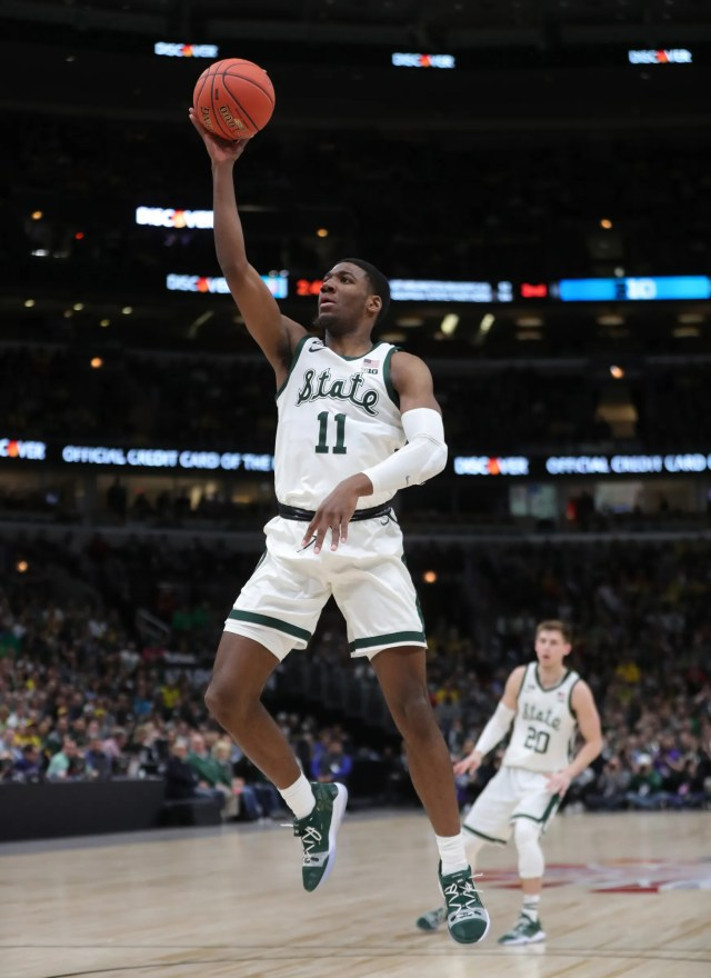 Michigan State's Aaron Henry scores against Michigan during the second half of the Big Ten tournament championship Sunday, March 17, 2019 in Chicago.