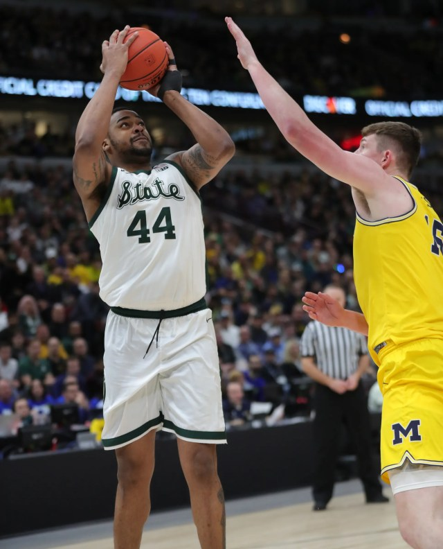 Michigan State's Nick Ward scores against Michigan's Jon Teske during the second half of the Big Ten tournament championship Sunday, March 17, 2019 in Chicago.