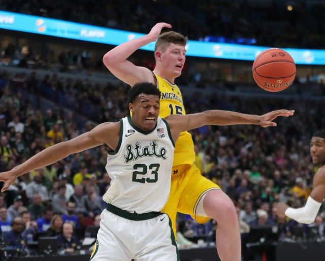 Michigan State's Xavier Tillman goes for the ball against Michigan's Jon Teske during the Big Ten tournament championship Sunday, March 17, 2019 in Chicago.