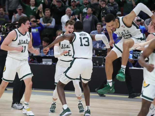 Michigan State's Connor George, Matt McQuaid, Gabe Brown and Kenny Goins celebrate the 65-60 win against Michigan in the Big Ten tournament championship Sunday, March 17, 2019 in Chicago.