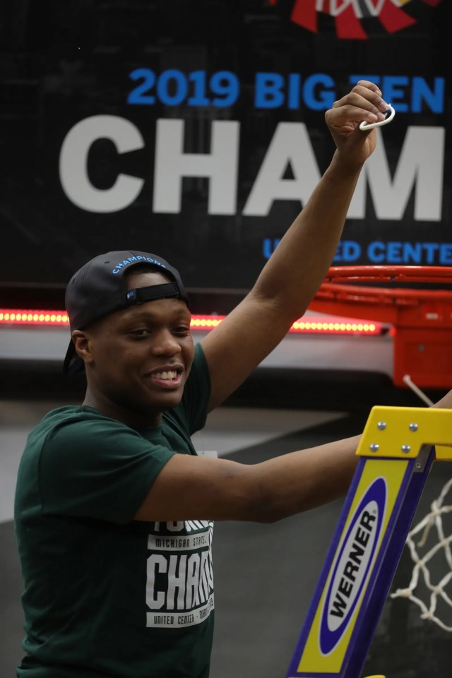 Michigan State guard Cassius Winston cuts the net after the 65-60 win against Michigan in the Big Ten tournament championship Sunday, March 17, 2019 in Chicago.
