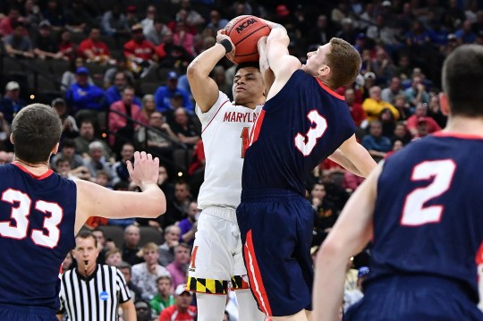 Belmont Bruins guard Dylan Windler (3) blocks a shot by Maryland Terrapins guard Anthony Cowan Jr. (1).