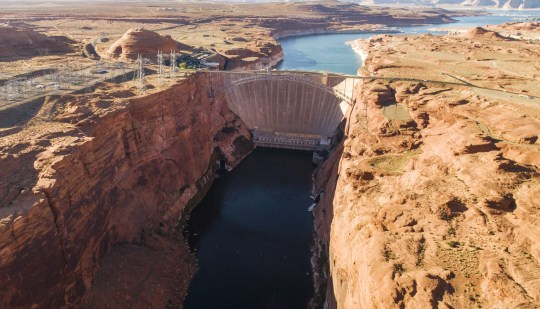 Glen Canyon Dam, near Page, permanently altered the flow of the Colorado River through the Grand Canyon, turning the flow from warm and muddy to cool and clear.