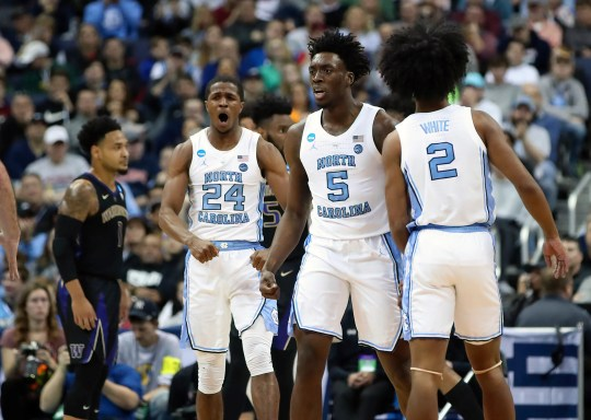 North Carolina Tar Heels guard Kenny Williams (24) celebrates with striker Nassir Little (5) and Coby White (2) against the Washington Huskies in the second round of the 2019 NCAA tournament in the Nationwide Arena.