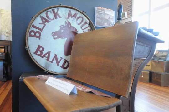 A drum from the the former Black Mountain High School can be found in the second floor gallery of the Swannanoa Valley Museum and History Center. The high school merged with Swannanoa High School in 1955 to form Charles D. Owen High School, where Black Mountain Dark Horses and Swannanoa Warriors were combined to create the Warhorses.