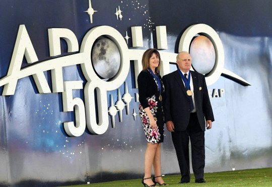 James F. Buchli and Janet L. Kavandi, representatives of the US Hall of Fame. UU., Represent photos on Saturday in the Visitor Center Kennedy Space Center.