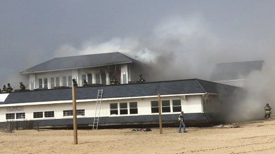 Smoke billows out of the Dunes Boardwalk Cafe at the north end of the Ocean Grove boardwalk Saturday, April 13, 2019.