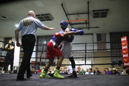 """Abimbola """"Abel"""" Osundairo, right, tackles Xavier Morales in a 178-pound semifinal contest at a Golden Gloves boxing competition March 21, 2019, at Cicero Stadium in Cicero, Ill. """"data-mycapture-sm-src ="""""""