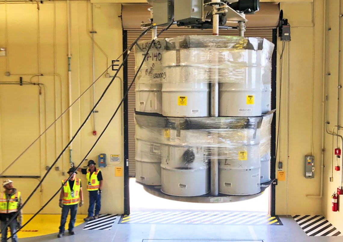 Transuranic waste barrels are loaded for transport to WIPP, the first TRU waste loading operations in five years at the Laboratory's RANT facility.
