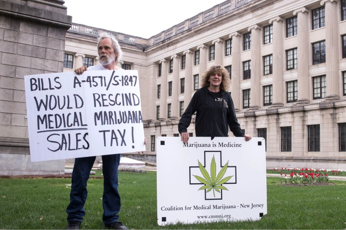 The Coalition for Medical Marijuana of New Jersey host a rally in front of the New Jersey statehouse to bring attention to marijuana legalization on the unofficial 420 holiday. Jim Miller, co-founder of CMMNJ and Kim Cushman of South Hampton protest about tax in front of the statehouse. 