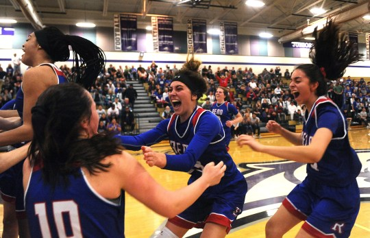 Reno's Mikayla Shults (23) celebrates with her teammates after defeating McQueen to win the northern region NIAA girls basketball championship game at Spanish Springs on Feb. 16, 2018.