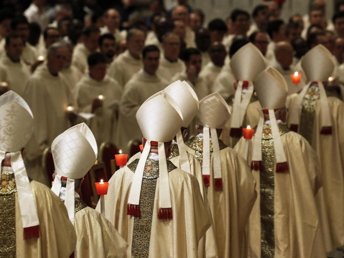 Prelates during the Easter Vigil mass at the Saint Peter's Basilica in Vatican City on April 20, 2019.
