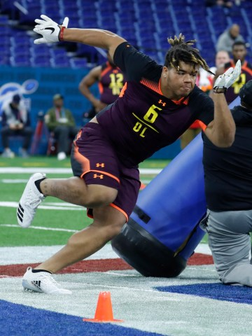 Trysten Hill goes through workout drills during the combine.