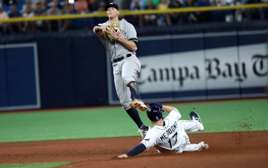 May 10, 2019; St. Petersburg, FL, USA UU., New York Yankees second baseman DJ LeMahieu (26) drives out right fielder Austin Meadows of the Tampa Bay Rays (17) and throws the ball to first base for a double play during the seventh entry into the Tropicana Field.