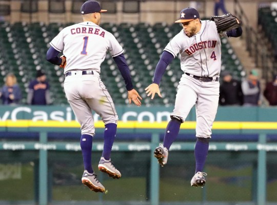Astros' Carlos Correa and George Springer celebrate the 8-1 win over the Tigers, Monday, at Comerica Park.