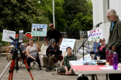 People gather for a Don't Punish Pain rally outside the Oregon State Capitol in Salem on May 22, 2019. Chronic pain patients rallied across the country Wednesday to fight restrictive opioid laws that patients say hurt those who rely on the medications to manage pain.