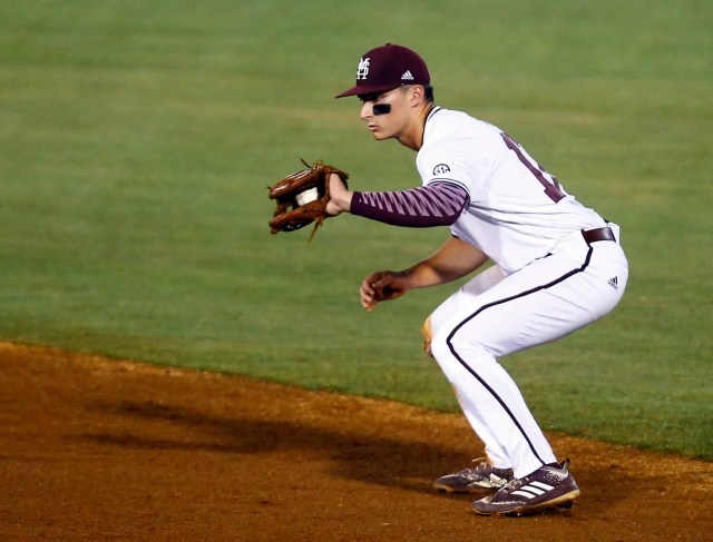 Mississippi State second baseman Justin Foscue fields a grounder from LSU's Antoine Duplantis during the third inning of a Southeastern Conference tournament NCAA college baseball game Wednesday, May 22, 2019, in Hoover, Ala. (AP Photo/Butch Dill)