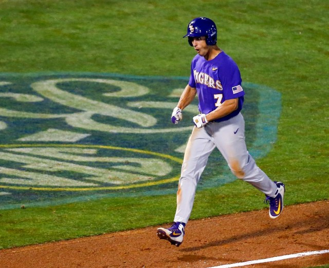 LSU's Giovanni DiGiacomo (7) celebrates after hitting a two run homer during the eighth inning of the Southeastern Conference tournament NCAA college baseball game against Mississippi State, Wednesday, May 22, 2019, in Hoover, Ala. (AP Photo/Butch Dill)