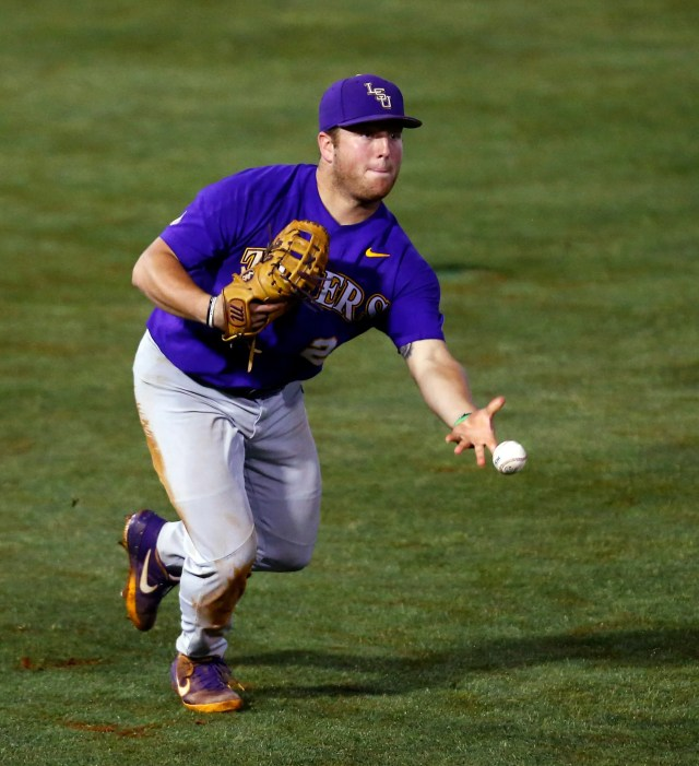 LSU first baseman Cade Beloso tosses to first for the out on Mississippi State's Marshall Gilbert during the 10th inning of the Southeastern Conference tournament NCAA college baseball game, early morning Thursday, May 23, 2019, in Hoover, Ala. (AP Photo/Butch Dill)