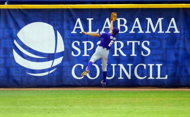 LSU right fielder Antoine Duplantis makes a catch near the wall for the out on Mississippi State's Dustin Skelton during the first inning of a Southeastern Conference tournament NCAA college baseball game,Wednesday, May 22, 2019, in Hoover, Ala. (AP Photo/Butch Dill)