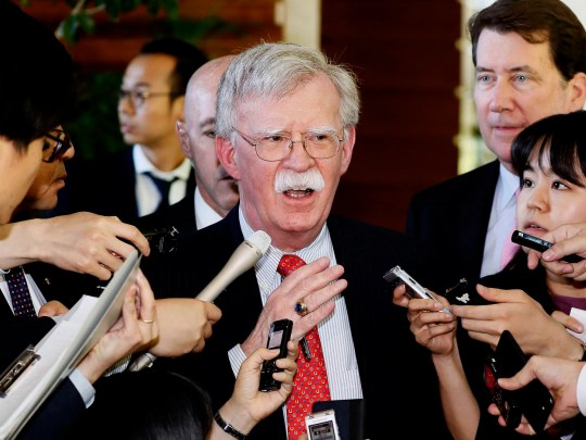 "In this Friday, May 24, 2019, file photo, U.S. National Security Adviser John Bolton is surrounded by reporters at the prime minister's official residence in Tokyo, Japan. North Korea on Monday, May 27, 2019, has called U.S. National Security Adviser Bolton a ""war monger"" and ""defective human product"" after he called the North's recent tests of short-range missile a violation of U.N. Security Council resolutions."