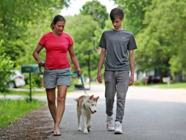 Johnna Magers, left, walks her dog, Luna, with her son, Jackson Woolsey, Friday, May 31, 2019.  She suffers from chronic pain and worries about pain medication guidelines that take medication from those who really need it.