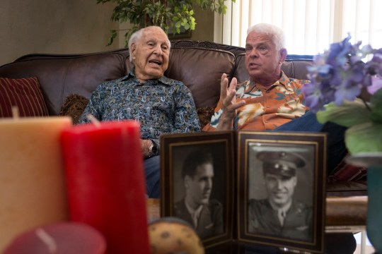 Fred Klein (left), a 103-year-old World War II veteran, and his son, Steve Klein, in the living room of Fred's Tucson home April 24, 2019.