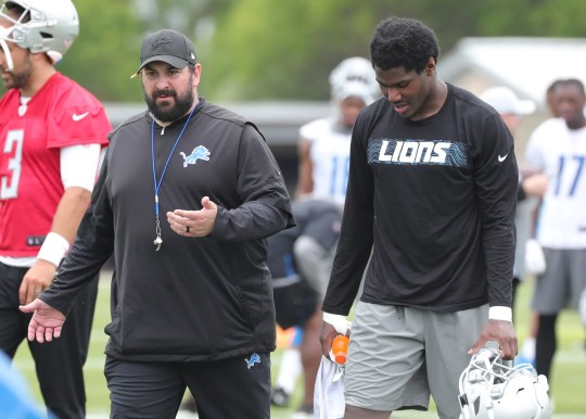 Lions coach Matt Patricia talks to Kerryon Johnson back after minicamp on Tuesday, June 4, 2019, in Allen Park.