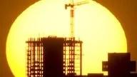 The sun sinks behind the downtown Phoenix skyline.