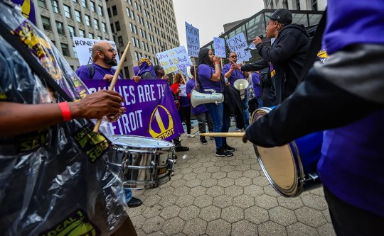 Union workers and non-collateral workers collect for a rally in front of the Ally building in the center of Detroit after a planned walk and strike Thursday, June 13, 2019, by private non-consolidated security guards at Bedrock owned buildings in the middle. Detroit. Local Service Body International Employees 1 announced the strike, which is trying to organize the workers and help them push $ 15 per hour.