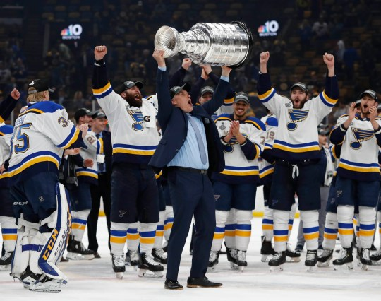 The Blues cheer as Craig Berube hoists the Stanley Cup. He was named interim coach in November.