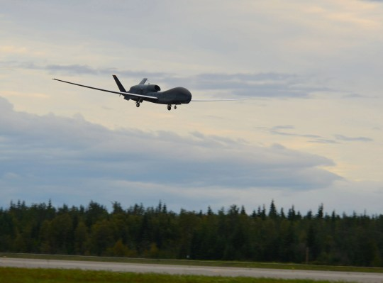 In this image released by the US Air Force, a RQ-4 Global Hawk unmanned surveillance drone lands on August 16, 2018, at Eielson Air Force Base, Alaska. - The Pentagon confirmed on June 20, 2019, that Iranian forces shot down a US naval surveillance drone but insisted the aircraft was in international air space, not that of Iran.