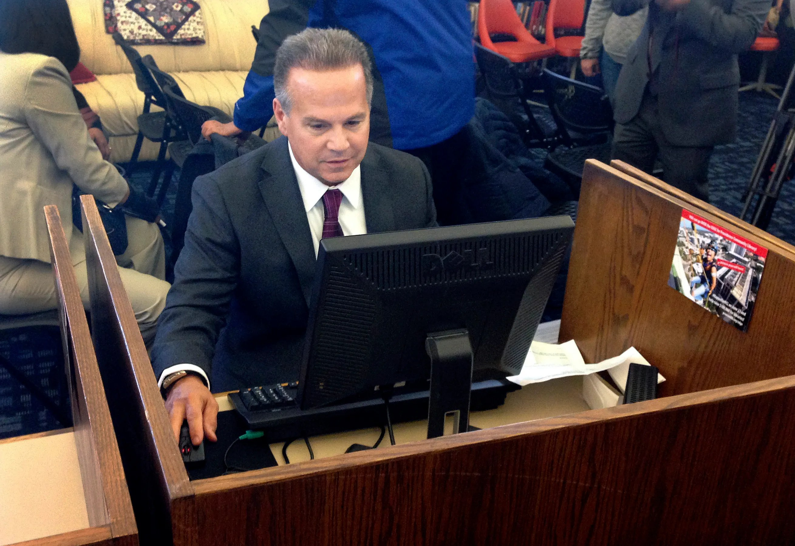 In this March 26, 2018 photo, U.S. Rep. David Cicilline completes his census form on a computer at a library in Providence, R.I., during the nation's only test run of the 2020 Census.