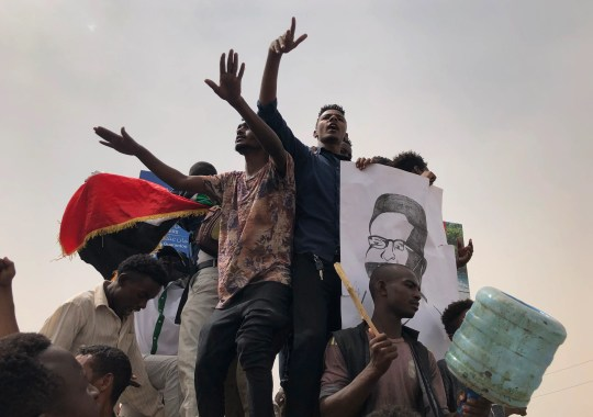 Sudanese protesters shout slogans during a demonstration against the ruling military council, in Khartoum, Sudan. Tens of thousands of protesters took to the streets in Sudan's capital and elsewhere in the country calling for civilian rule nearly three months after the army forced out long-ruling autocrat Omar al-Bashir.