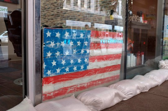 Sandbags line store front of a New Orleans barber shop in preparation for Tropical Storm Barry in New Orleans, Louisiana, on July 11, 2019.